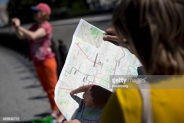Visitors look at a map on the south side of the White House in Washington DC US on Monday Sept 22 2014 A security review prompted by an intruder...