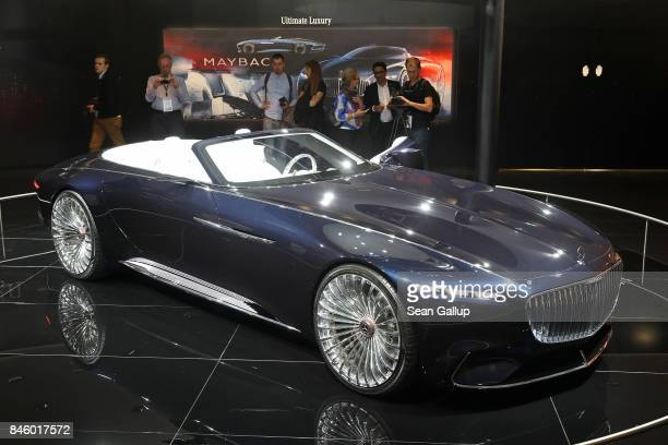 Visitors look at a MercedesMaybach 6 Cabriolet at the 2017 Frankfurt Auto Show on September 12 2017 in Frankfurt am Main Germany The Frankfurt Auto...