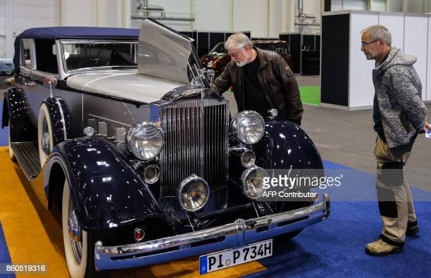 Visitors look at a Packard Eight dated 1934 on October 12 2017 in Hamburg on the eve of the opening of the first edition of the 'Motor Classics' show...