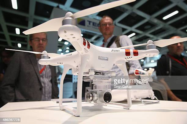 Visitors look at a Phantom 3 Standard quadcopter drone at the DJI stand during a press day at the 2015 IFA consumer electronics and appliances trade...