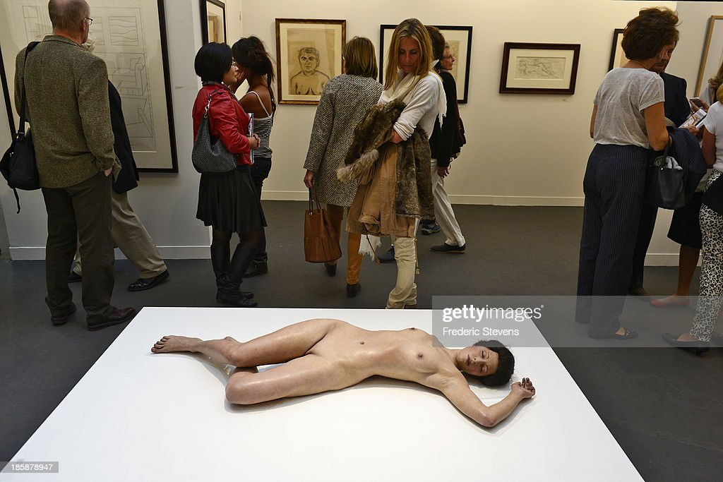 Visitors look at a piece by American artist John de Andrea entitled 'Lisa' at the Grand Palais as part of the exhibition of the FIAC International Contemporary Art Fair on October 25, 2013 in Paris, France. This is the 40th anniversary edition of