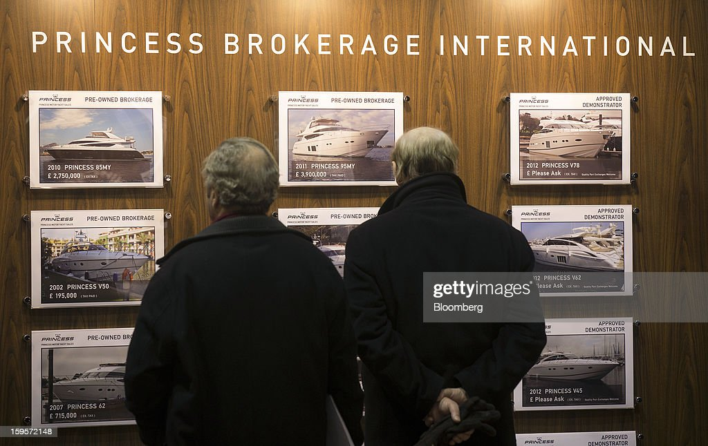 Visitors look at a sales display of pre-owned luxury yachts manufactured by Princess Yachts International Plc, part of the LVMH Moet Hennessy Louis Vuitton SA group, during the Tullet Prebon London Boat Show 2013 at the ExCeL center in London, U.K., on Wednesday, Jan. 16, 2013. The show, Europe's first in 2013, will showcase new sailing craft from dinghies to luxury yachts, and runs Jan. 12-20. Photographer: Simon Dawson/Bloomberg via Getty Images
