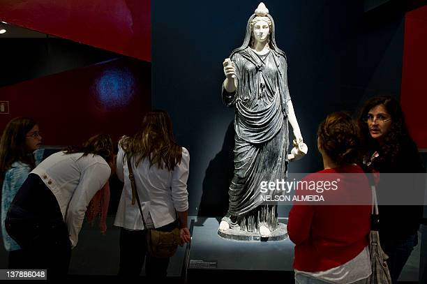 Visitors look at a sculpture displayed at the exhibition 'Rome The Life and Emperors' at the Art Museum of Sao Paulo on January 28 in Sao Paulo...