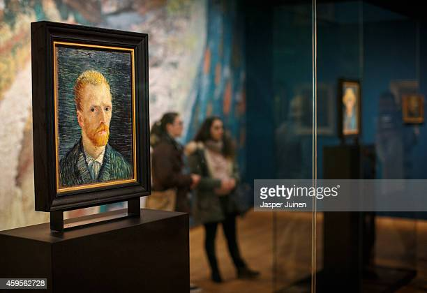 Visitors look at a self portraits of Dutch PostImpressionist painter Vincent van Gogh on the ground floor of the Vincent van Gogh museum on November...