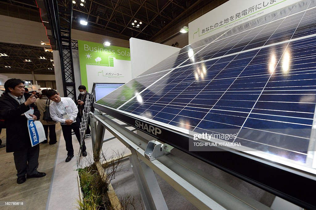 Visitors look at a Sharp solar panel module at the company's booth during the PV Expo in the World Smart Energy Week 2013 in Tokyo on February 27, 2013. About 1,890 companies from 30 nations are participating in the three-day energy exhibition starting February 27.