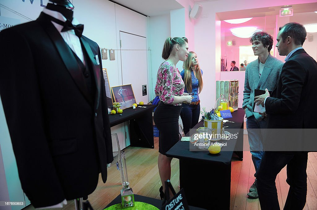 Visitors look at a suit stand at the gay marriage show on April 27, 2013 in Paris, France. The show takes place four days after France legalised same-sex marriage at the National Assembly.