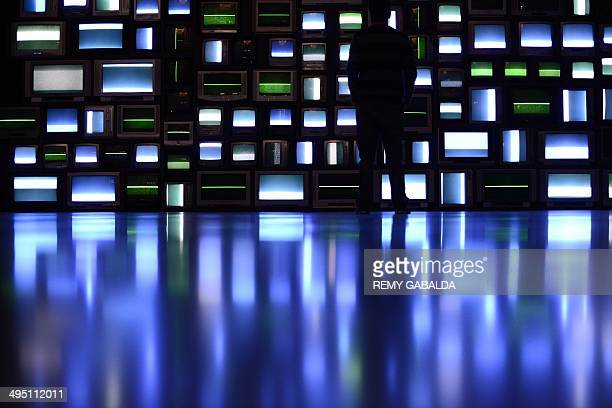 Visitors look at a video installation comprising of 106 TV sets by American artist Susan Hiller in the Abattoirs Museum in Toulouse southern France...