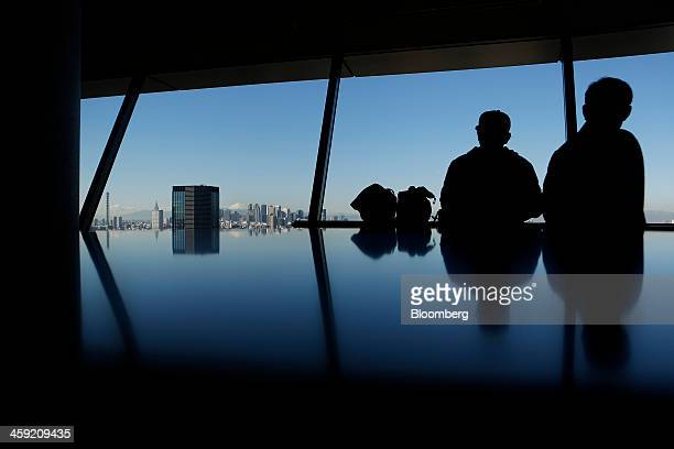 Visitors look at a view of the city skyline from an observation deck in Tokyo Japan on Tuesday Dec 24 2013 Japan unveiled a record budget for the...
