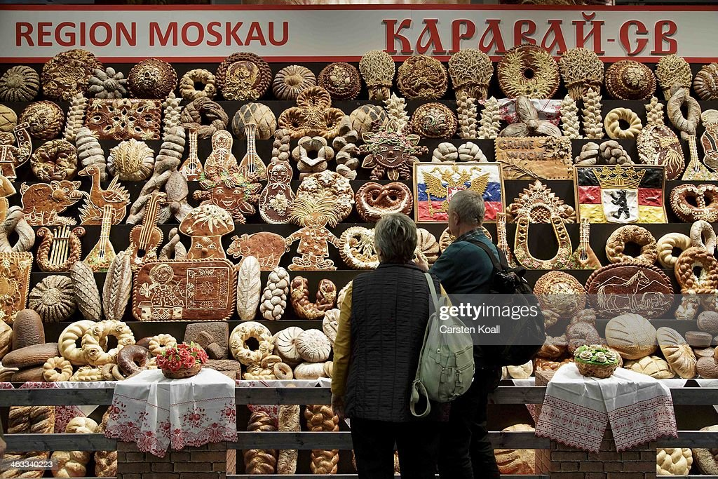Visitors look at a wall with several typica russian breads at the russian stand at the Gruene Woche agricultural trade fair on January 17, 2014 in Berlin, Germany. The Gruene Woche is the world's largest agricultural trade fair and is open to the public until January 26.