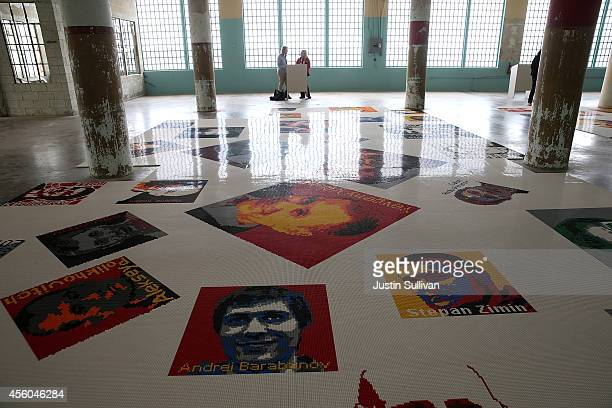 Visitors look at Ai Weiwei's 'Trace' installation at the @Large Ai Weiwei on Alcatraz on September 24 2014 in San Francisco California The new @Large...