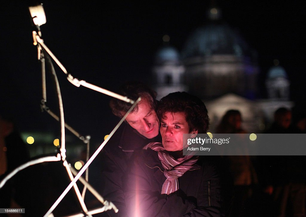 Visitors look at an animated car battery-powered mechanical stick figure in front of the Berliner Dom (Berlin Cathedral) during a presentation by the French fire performers Carabosse as part of celebrations marking the 775th anniversary of the city of Berlin on October 28, 2012 in Berlin, Germany. The settlement of Coelln, which stood opposite Berlin on the Spree river, is first referred to in a document from 1237, and by the beginning of the 14th century Coelln and Berlin joined together to become the region's most important trading center.