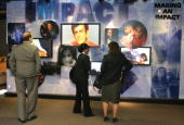 Visitors look at an exhibit during the grand opening of the new Arab American National Museum May 5 2005 in Dearborn Michigan The museum is the first...