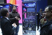 Visitors look at an IBM z13 mainframe computer at the IBM stand at the 2015 CeBIT technology trade fair on March 16 2015 in Hanover Germany China is...