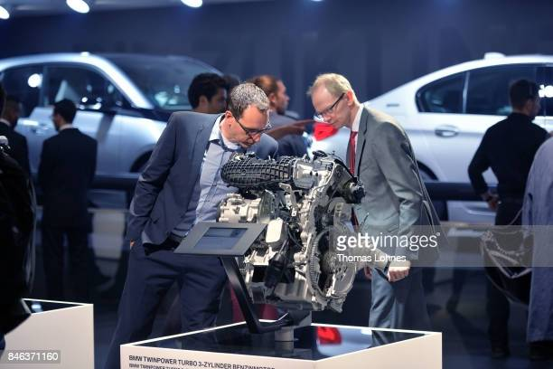 Visitors look at BMW Twinpower Turbo3Cylinder petrol engine at the 2017 Frankfurt Auto Show 'Internationale Automobil Ausstellung' on September 13...