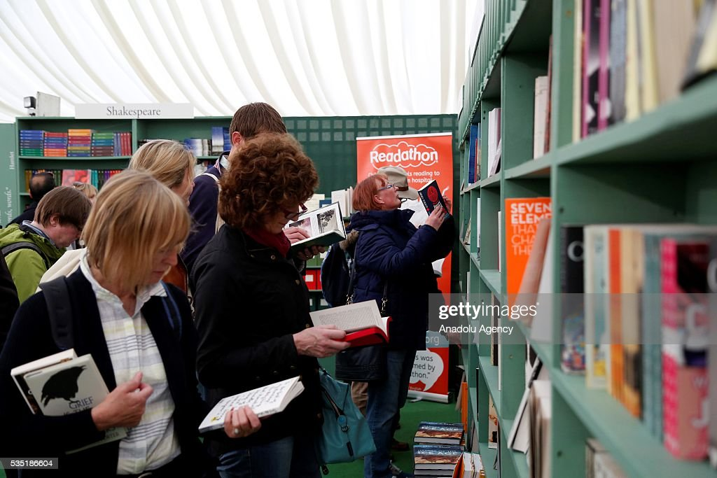 Visitors look at books during the Hay Festival on May 29, 2016 in Hay-on-Wye, Wales. The Hay Festival is an annual festival of literature and arts now in its 29th year.