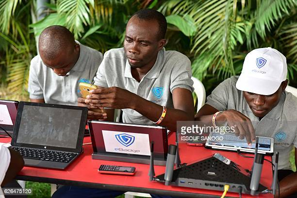 Visitors look at computers phones and tablets by ebadge on the first day of the 2016 Africa Web Festival in Abidjan on November 29 2016 The festival...