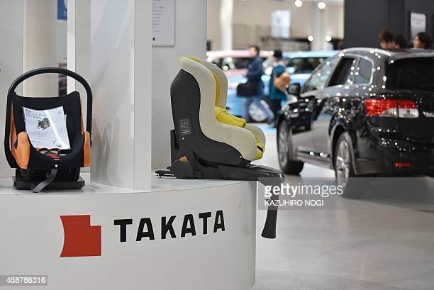 Visitors look at displays of Japanese auto parts maker Takata Corp at a car showroom in Tokyo on November 11 2014 Shares in Japanese auto parts firm...