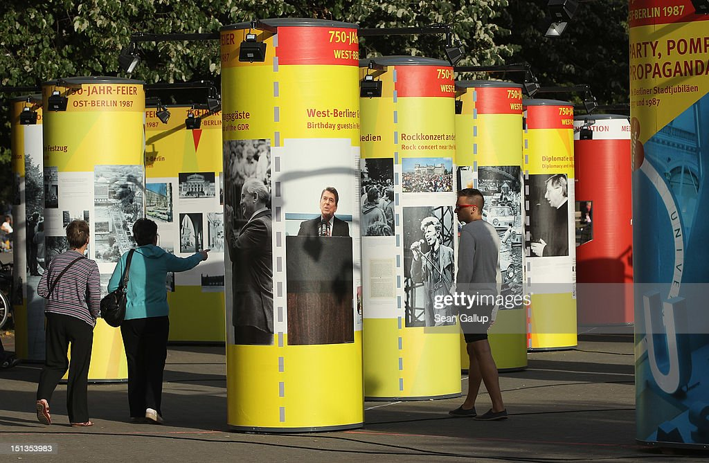 Visitors look at documentation from the 750th anniversary of the city 25 years ago at an outdoor exhibit on September 6, 2012 in Berlin, Germany. The city of Berlin is currently holding a series of exhibitions and events ahead of its 775th anniversary, which it will celebrate at the end of October. Berlin's sister settlement of Coelln is first referred to in a document from 1237, and by the beginning of the 14th century Coelln and Berlin, which stood on either side of the Spree River, joined together to become the region's most important trading center.