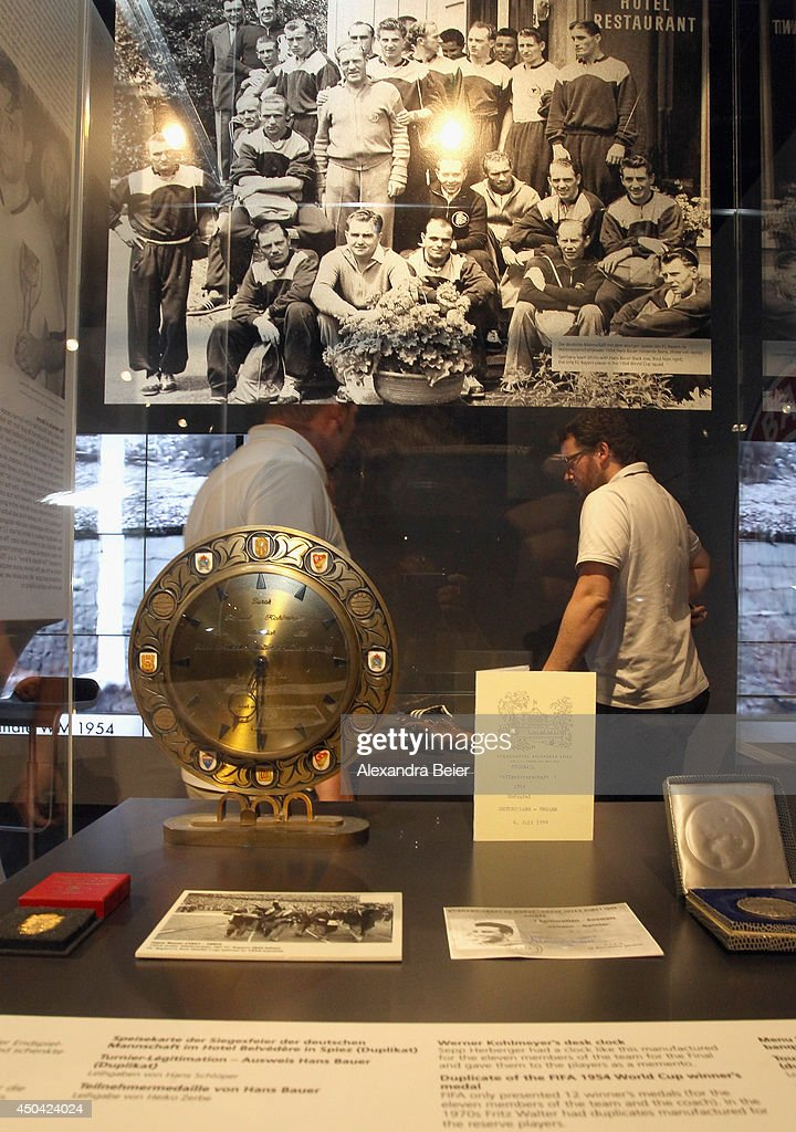Visitors look at exhibits during the opening day of a World Cup 1954 exhibition at Allianz Arena Erlebniswelt museum on June 11, 2014 in Munich, Germany.