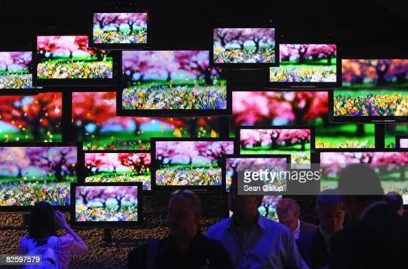 Visitors look at flat panel LCD televisions at the Panasonic Viera stand at the IFA consumer electronics trade fair on August 29 2008 in Berlin...