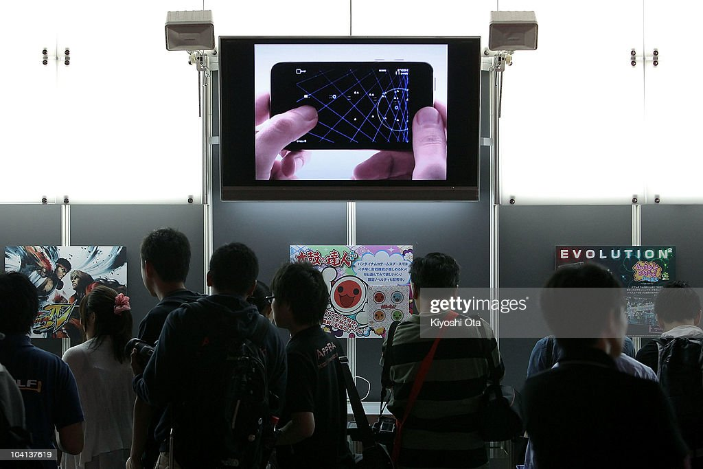 Visitors look at game titles for Apple Inc.'s iPad tablet computers and iPhone mobile handsets during the Tokyo Game Show 2010 at Makuhari Messe on September 16, 2010 in Chiba, Japan. The computer and video game convention, which will be held until September 19, features exhibitions of upcoming game software and hardware from 194 companies and organizations to draw business visitors and the general public.