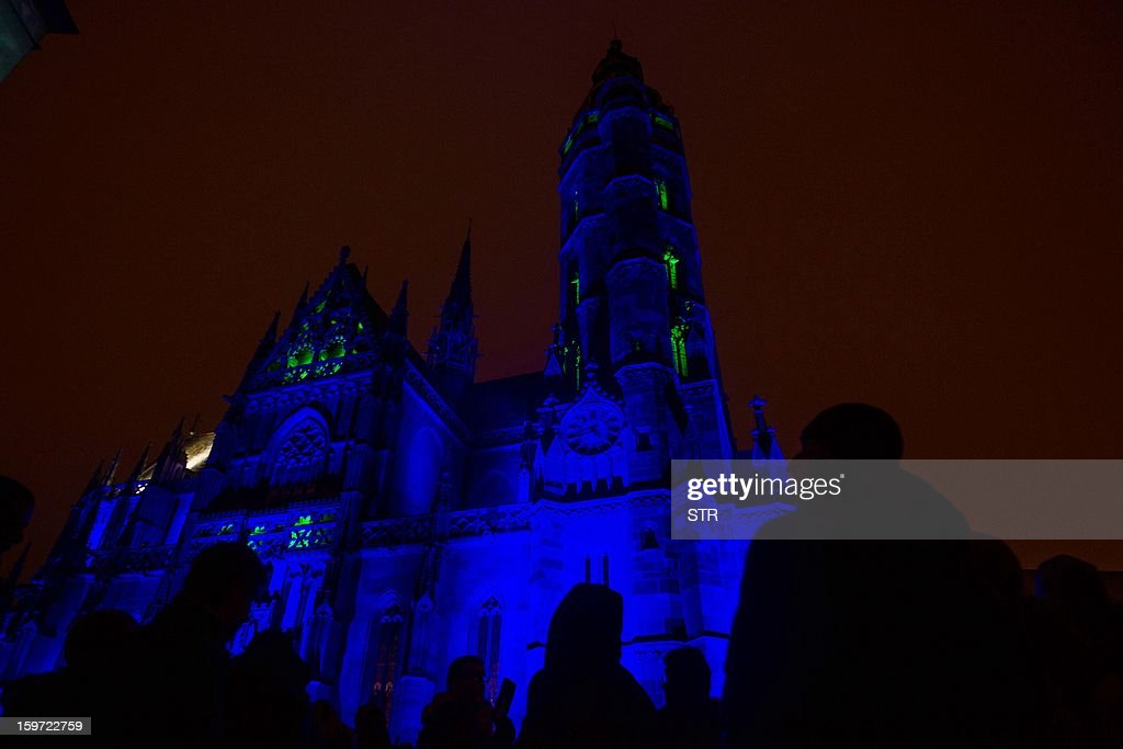 Visitors look at illuminated St.Elizabeth's Cathedral during the opening ceremony of the European capital of culture Kosice 2013, in Kosice on January 19, 2013. AFP PHOTO / STR