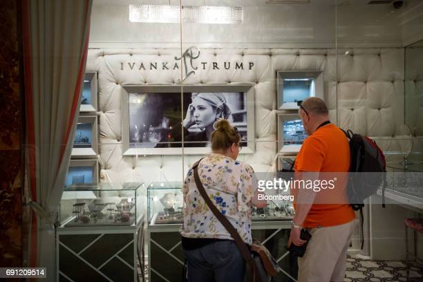 Visitors look at jewelry displayed in the window of the Ivanka Trump Collection store at Trump Tower in New York US on Thursday June 1 2017 Two...
