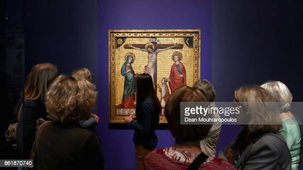 Visitors look at Memorial Tablet of Hendrik van Rijn in the Johan Maelwael special exhibition held at Rijksmuseum Exhibition on October 13 2017 in...