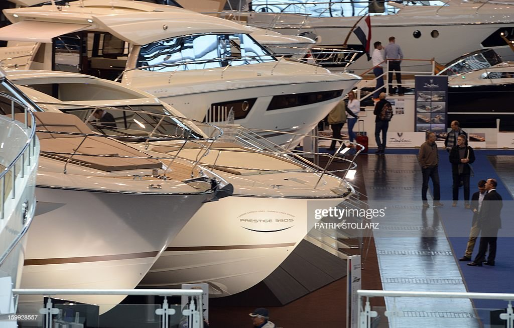 Visitors look at motorboats at the Duesseldorf fairground during the Boot fair International Boat Show on January 23, 2013. The event, running from January 19 to January 27, features all boats, yachts, superyachts, electronics, engines and thousands of accessories from every major marine manufacturer and builder worldwide.
