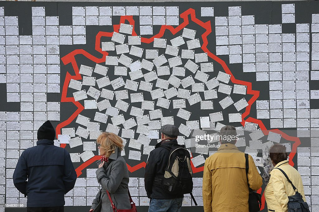 Visitors look at notes left by passers by in the shape of the city of Berlin during celebrations marking the 775th anniversary of Berlin on October 27, 2012 in Berlin, Germany. Celebrations are continuing over the weekend and will culminate in a fire presentation by the French fire performers Carabosse on Sunday. The settlement of Coelln, which stood opposite Berlin on the Spree river, is first referred to in a document from 1237, and by the beginning of the 14th century Coelln and Berlin joined together to become the region's most important trading center.