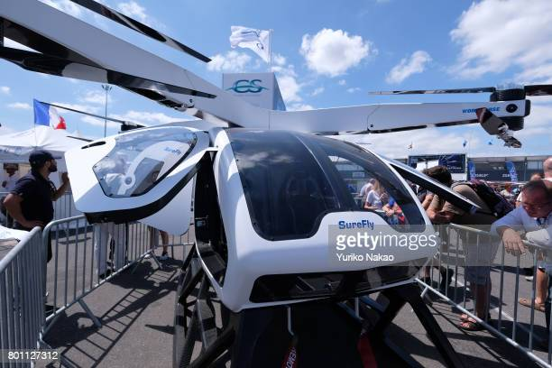 Visitors look at 'nWorkhorse Group Inc 's SureFly Helicopter Concept displayed at the Le Bourget Airport on the first public day of the 52nd...