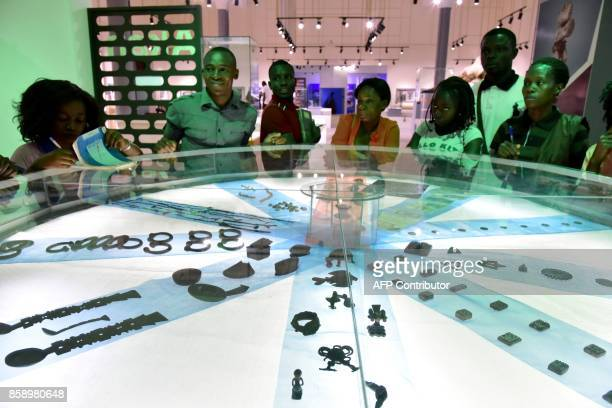 Visitors look at objects exhibited at the Civilisation Museum of Abidjan on September 29 2017 during the first exhibition called 'Renaissance'...