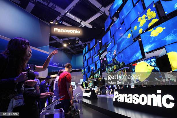 Visitors look at Panasonic Smart Viera flatscreen television at the Internationale Funkausstellung 2012 consumer electronics trade fair on August 31...