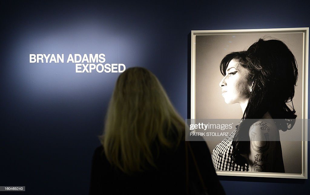 Visitors look at photographs taken by Canadian singer and photographer Bryan Adams on February 1, 2013 at the Museum NRW forum in Duesseldorf, western Germany. The exhibition shows from January 2 until May 22, 2013 portraits of Artists photographed by Canadian singer Bryan Adams in the NRW forum in Düsseldorf , Germany.
