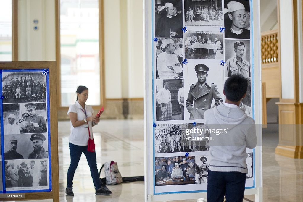 Visitors look at pictures of General <a gi-track='captionPersonalityLinkClicked' href=/galleries/search?phrase=Aung+San&family=editorial&specificpeople=812845 ng-click='$event.stopPropagation()'>Aung San</a> inside the theatre hall in parliament in NayPyiDaw on February 11, 2015. Celebrations will mark a hundred years since the birth of <a gi-track='captionPersonalityLinkClicked' href=/galleries/search?phrase=Aung+San&family=editorial&specificpeople=812845 ng-click='$event.stopPropagation()'>Aung San</a>, on February 13, 1915, Myanmar's independence hero and father of opposition leader <a gi-track='captionPersonalityLinkClicked' href=/galleries/search?phrase=Aung+San&family=editorial&specificpeople=812845 ng-click='$event.stopPropagation()'>Aung San</a> Suu Kyi. General <a gi-track='captionPersonalityLinkClicked' href=/galleries/search?phrase=Aung+San&family=editorial&specificpeople=812845 ng-click='$event.stopPropagation()'>Aung San</a> and eight other leaders were assassinated on July 19, 1947 just one year before their cherished goal of independence from Britain was achieved.