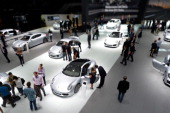 Visitors look at Porsche cars at the IAA international automobile show on September 11 2013 in Frankfurt Germany The 2013 IAA will be open to the...