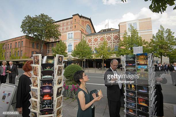 Visitors look at postcards at the Bayreuth Festival on August 12 2014 in Bayreuth Germany