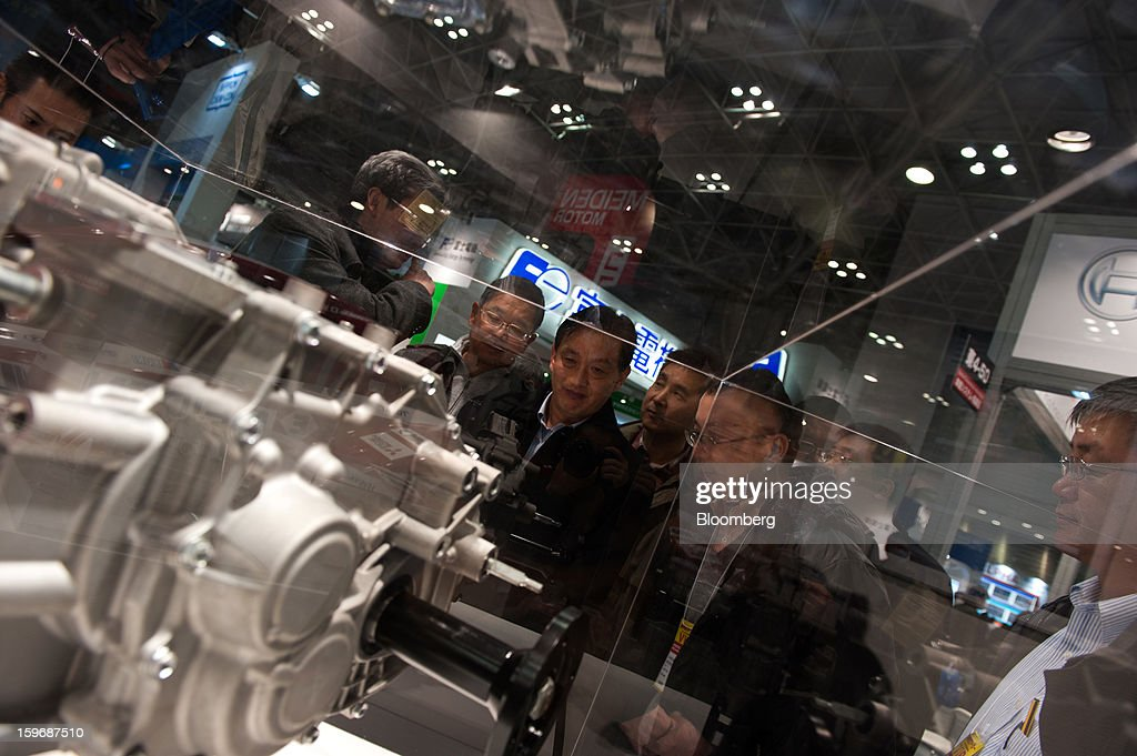 Visitors look at products displayed at Automotive World 2013 in Tokyo, Japan, on Friday, Jan. 18, 2013. The Automotive World 2013 trade show ends today. Photographer: Noriko Hayashi/Bloomberg via Getty Images