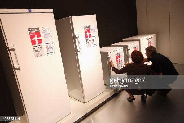 Visitors look at refrigerators at the Liebherr stand at the IFA 2011 consumer electonics and appliances trade fair on the first day of the fair's...