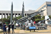 Visitors look at replicas of North Korean ScudB missile and South Korean Nike missiles at the Korean War Memorial in Seoul on March 26 2014 North...