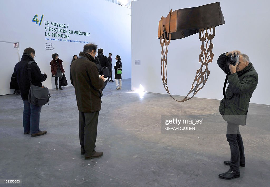 Visitors look at sculptures on display at the Tour Panorama (Panorama Tower), part of the 'Friche de la Belle de Mai' cultural area, on January 10, 2013, in Marseille, southern France, as one of a number of exhibitions opening in Marseille in relation to the city being named 2013 European 'Capital of Culture'. On January 12, the city will be named 'Capital of Culture' which will kick off a range of exhibitions and events.