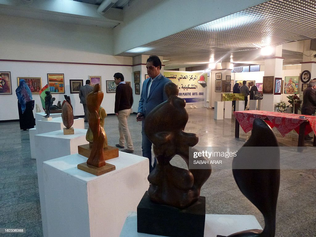 Visitors look at scuptures displayed during an exhibition devoted to the work of Arab and Iraqi artists on January 22, 2013 at Center for Fine Arts at the Ministry of Culture in the Iraqi capital Baghdad.