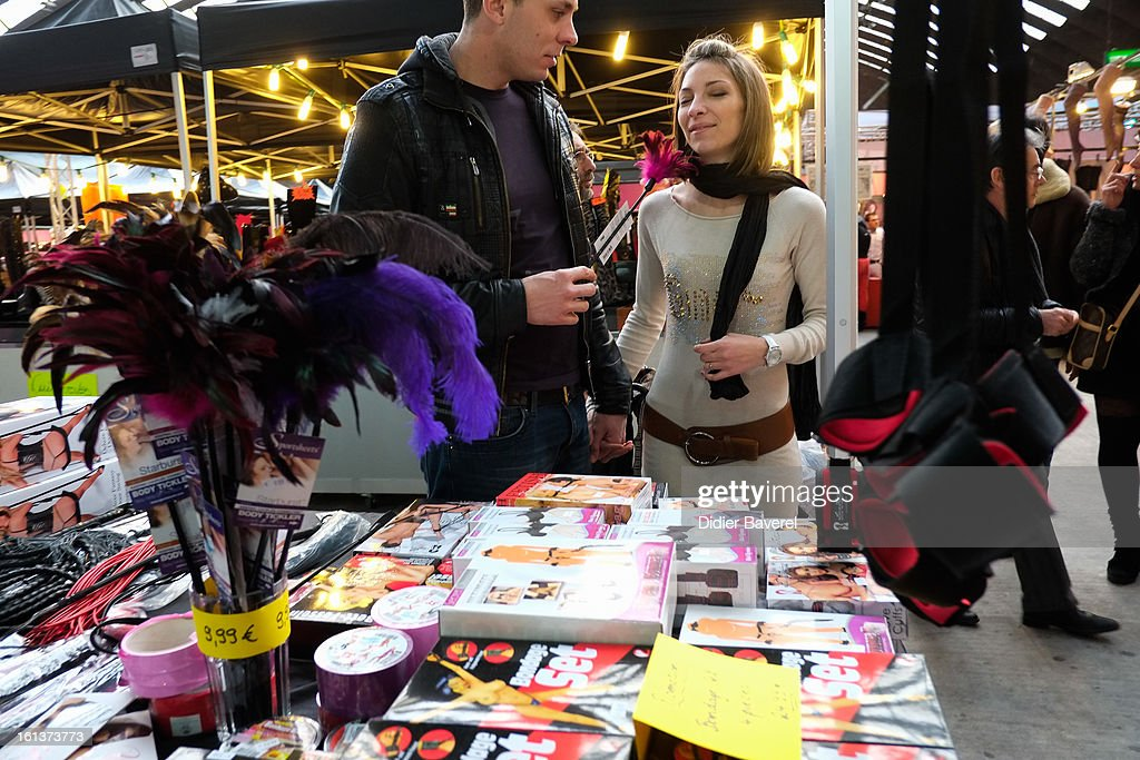 Visitors look at sextoys at Eropolis erotic fair at Acropolis on February 10, 2013 in Nice, France.