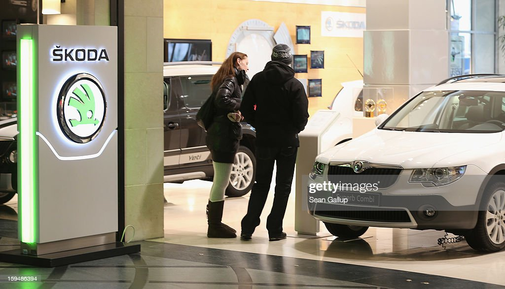 Visitors look at Skoda cars at a Volkswagen Group showroom on January 14, 2013 in Berlin, Germany. Volkswagen Group, which includes the VW, Audi, Porsche, Skoda, SEAT, Bentley and Bugatti brands, delivered a record 9.07 million cars to customers in 2012. Rising sales in the Americas and Asia helped to offset a drop in sales in western Europe.