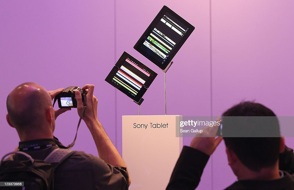 Visitors look at Sony tablet PCs at the Sony stand at the IFA 2011 consumer electonics and appliances trade fair on the first day of the fair's official opening on September 2, 2011 in Berlin, Germany. The IFA 2011 will be open to the public from September 2-7.