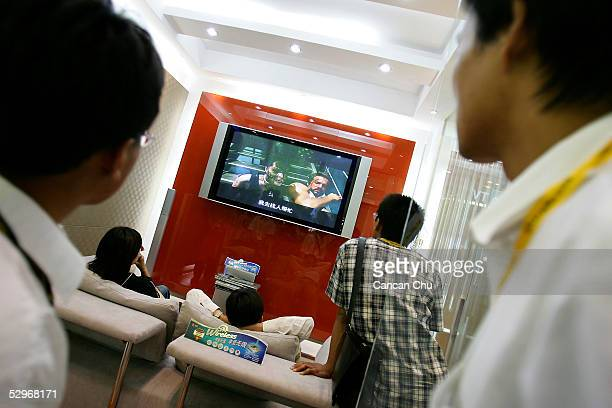 Visitors look at South Korea's LG wireless home theater system at the China International Hightech Expo on May 23 2005 in Beijing China China the...