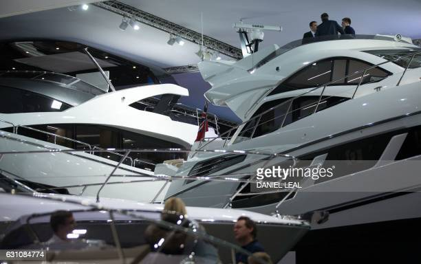 Visitors look at Sunseeker British luxury motor yachts at the 2017 London Boat Show in east London on January 6 2017 The capital citys iconic London...