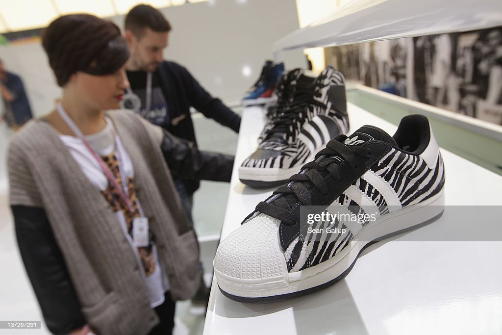 Visitors look at the adidas Originals Fall/Winter 2012 collection at the adidas Originals stand at the Bread and Butter 2012 fashion trade fair on January 18, 2012 in Berlin, Germany.