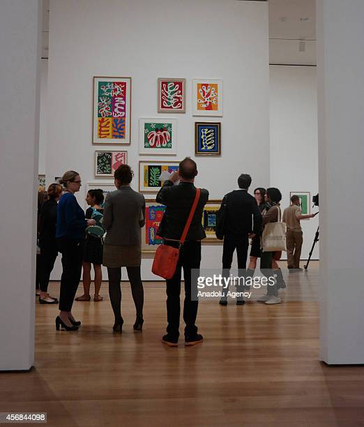 Visitors look at the art works by the French artist Henri Matisse during the Private View of upcoming exhibition entitled 'Henri Matisse The CutOuts'...