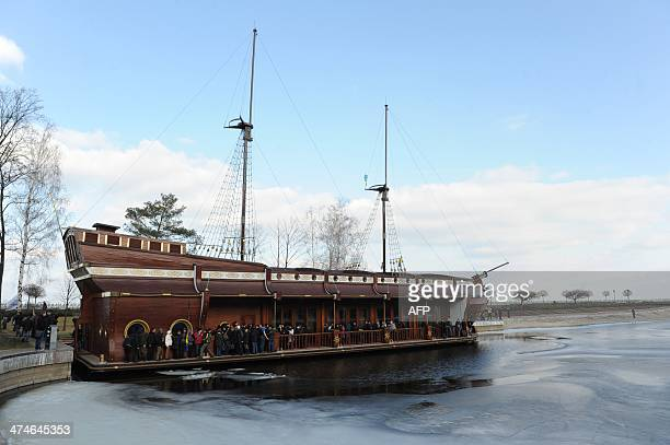 Visitors look at the boatshaped 'Galleon' restaurant inside the compound of the luxury residence of former Ukrainian President Viktor Yanukovych not...